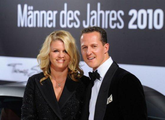 Michaelis Schumacheris su žmona Corinna 2010-ųjų spalį