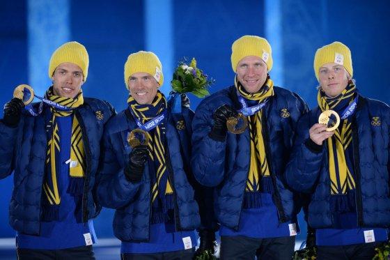 """AFP/""""Scanpix"""" nuotr./Švedijos slidininkų rinktinė: Larsas Nelsonas, Danielis Richardssonas, Johanas Olssonas ir Marcusas Hellneris"""