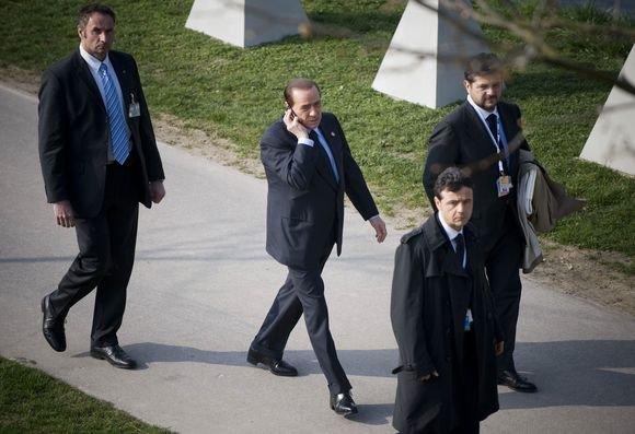 AFP/Scanpix nuotr./Silvio Berlusconi NATO viraūnių susitikime