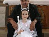 Irmanto Gelūno/15min.lt nuotr./Septynmetė aktoriaus anūkė Tija priėmė krikšto sakramanetą.