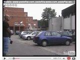 youtube.com stop kadras/Atsitiktinai D.Kedžio filmuotoje medžiagoje į kadrą pakliuvęs plikis, ant kurio krito žudynių bendrininko šešėlis.