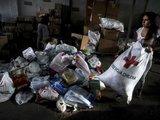 """""""Reuters""""/""""Scanpix"""" nuotr./Humanitarinė pagalba nuo žemės drebėjimo nukentėjusiems žmonėms"""