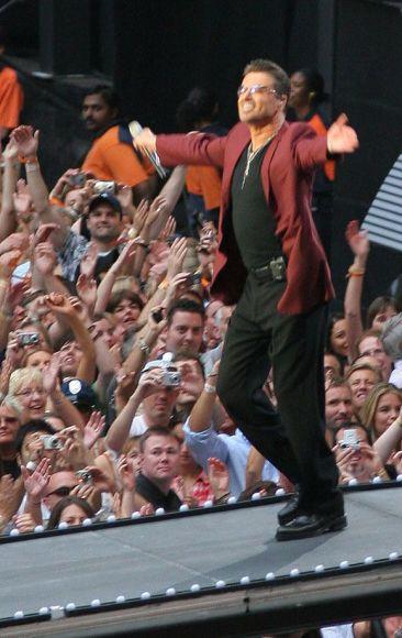 Scanpix nuotr./Būdamas scenoje, George'as geba užvesti didžiules žmonių minias