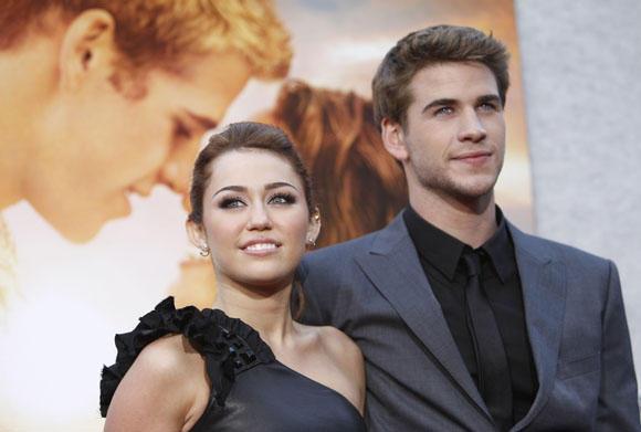 Scanpix nuotr./Miley Cyrus nekantrauja sulaukti savo pilnametystės, kad kuo greičiau ištekėtų už Liamo Hemswortho.