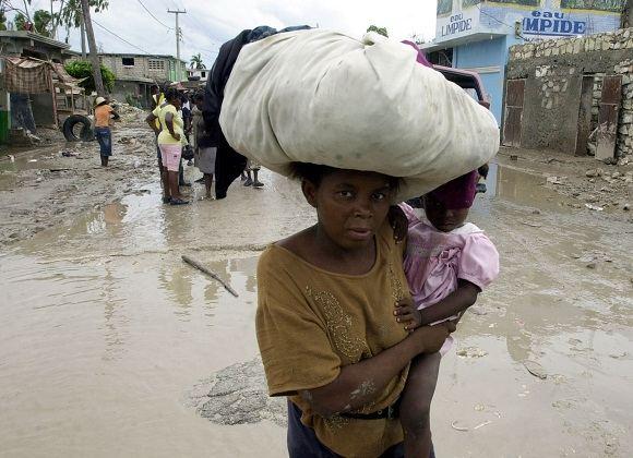 Scanpix nuotr./Haitis  viena ia prasčiausių vietų gyventi moteriai