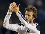 """AFP/""""Scanpix"""" nuotr./D.Beckhamas žibėjo"""