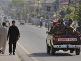 Reuters/Scanpix nuotr./Pakistano kariai Abotabado gatvėje