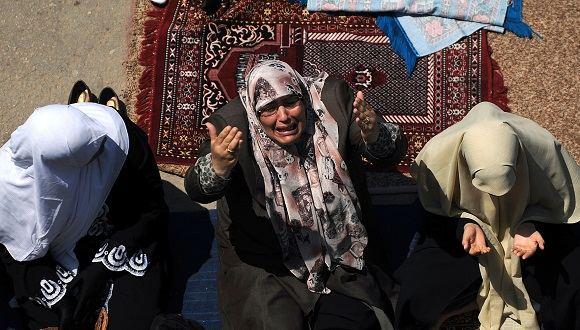 AFP/Scanpix nuotr./Prievartą patyrusios moterys dažniausiai tampa atstumtosiomis