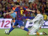 AFP/Scanpix nuotr./Lionelis Messi ir Cristiano Ronaldo (deainėje)