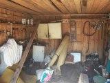 Irmanto Gelūno/15min.lt nuotr./Garažuose esantį turtą fiksavo antstoliai.
