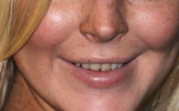 Scanpix nuotr./Lindsay Lohan dantys
