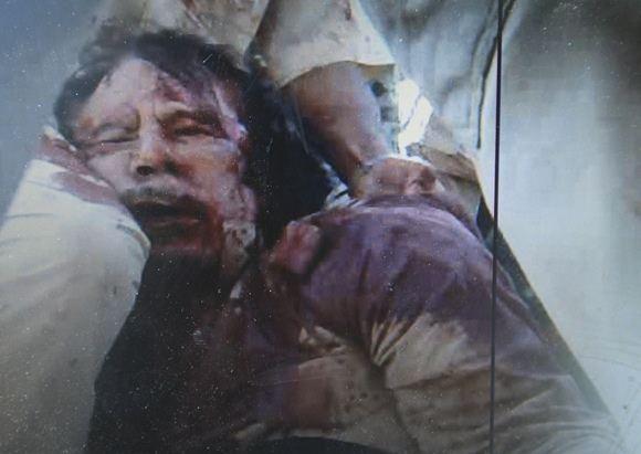 Reuters/Scanpix nuotr./Muamaras Kadhafi