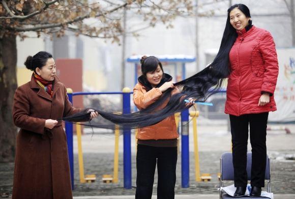 Reuters/Scanpix nuotr./Ni Linmei plaukų nekirpo jau 14 metų.
