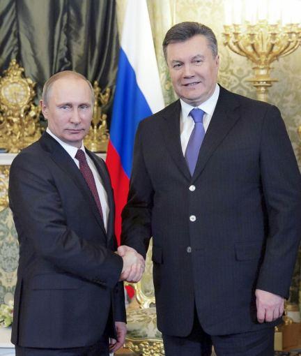 """AFP/""""Scanpix"""" nuotr./Rusijos prezidentas Vladimiras Putinas ir Ukrainos prezidentas Viktoras Janukovyčius"""