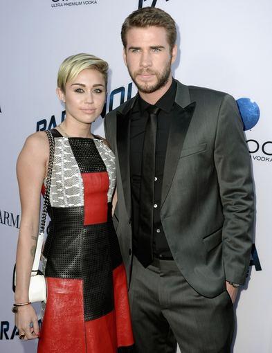 "AFP/""Scanpix"" nuotr./Liamas Hemsworthas ir Miley Cyrus"