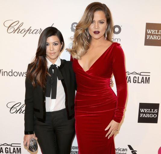 "AFP/""Scanpix"" nuotr./Kourtney Kardashian ir Khloe Kardashian"