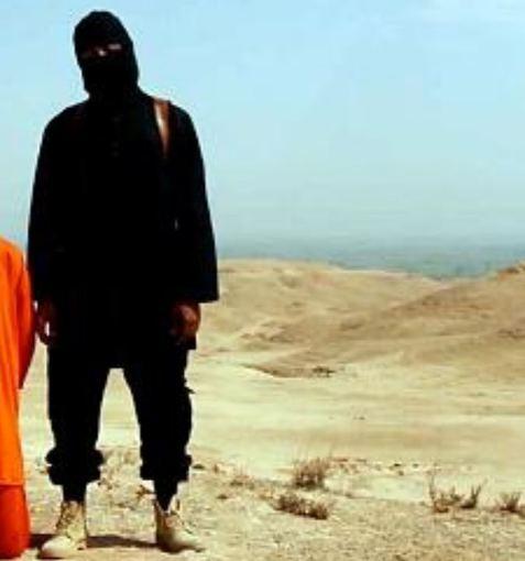 Kadras iš filmuotos medžiagos/JAV žurnalisto egzekucija