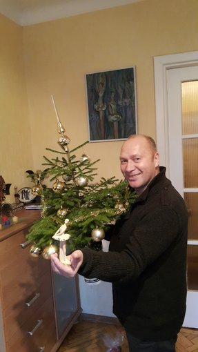 Asmeninio albumo nuotr./Jurijus Smoriginas prie Kalėdų eglės